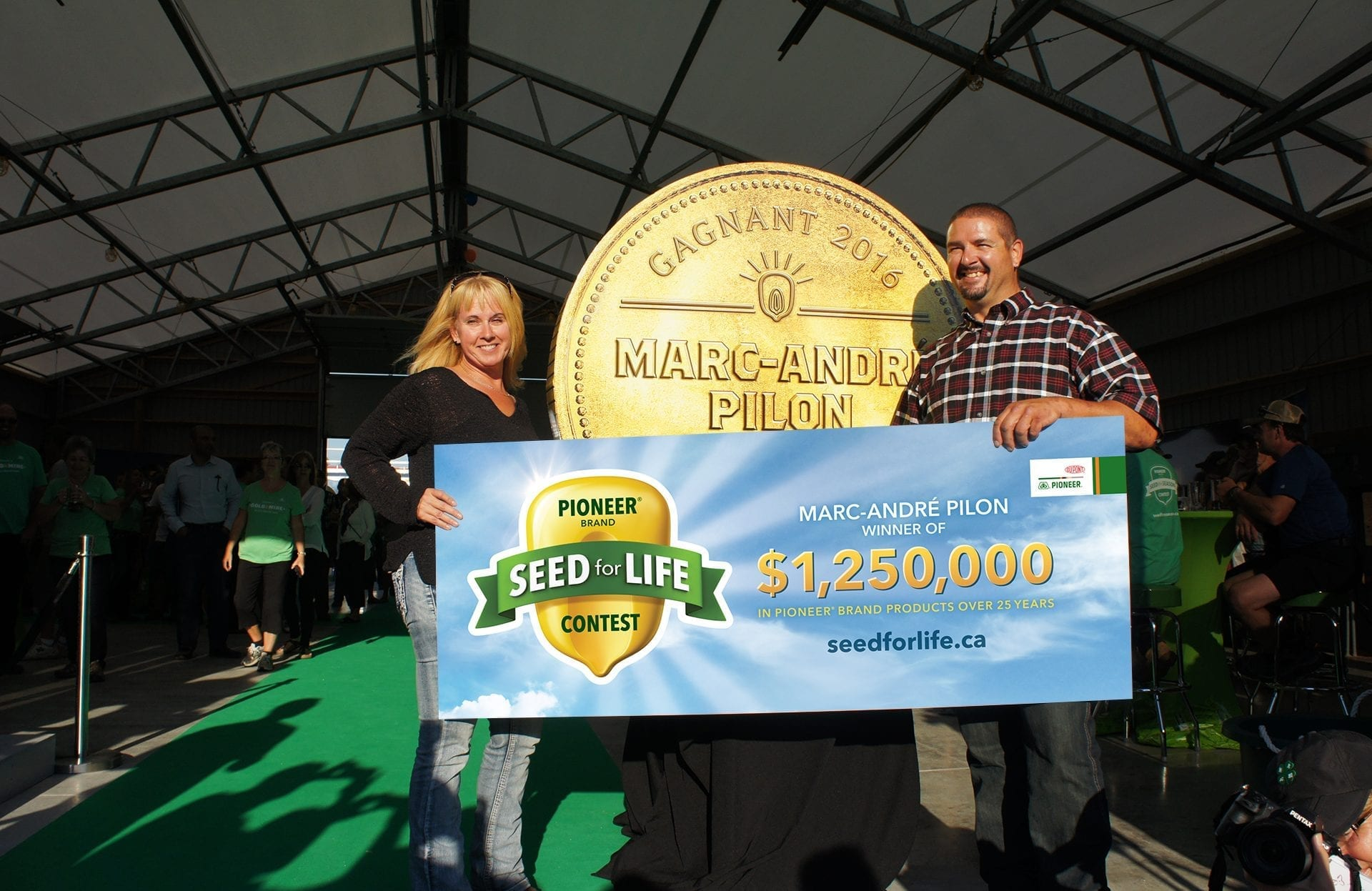 DuPont Pioneer Seed for Life grand prize winner coin and banner