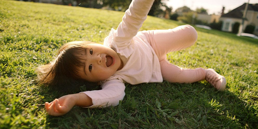 Baby happy and crawling around on grass